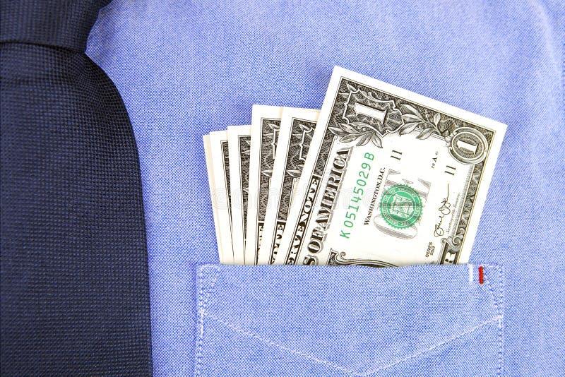Banconote del dollaro in tasca della camicia fotografie stock libere da diritti