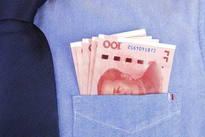 Banconote di RMB in tasca della camicia fotografia stock