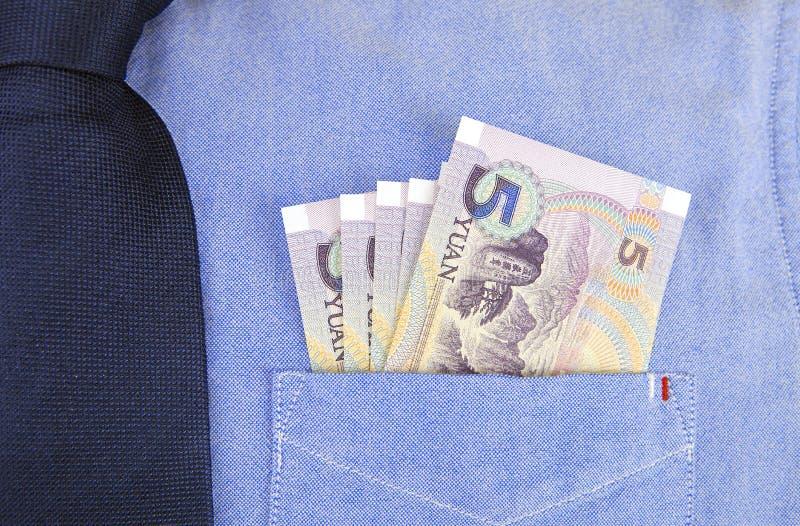 Banconote di RMB in tasca della camicia fotografie stock libere da diritti
