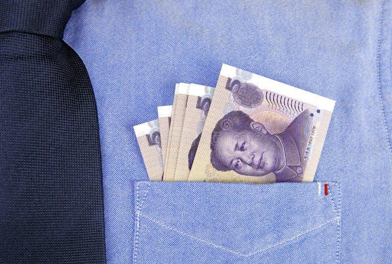 Banconote di RMB in tasca della camicia fotografia stock libera da diritti