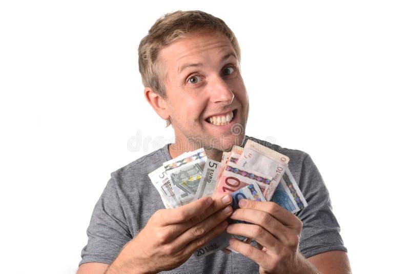 Banconote felici della tenuta dell'uomo immagini stock