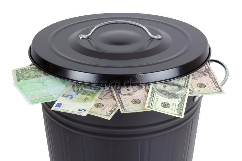 Banconote in una pattumiera fotografia stock
