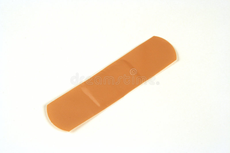 Band aid. Caucasian skin colored band aid on a white background stock photo
