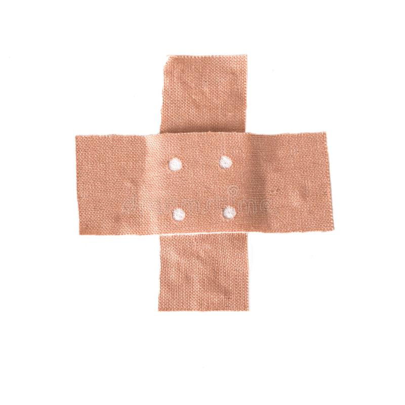 Band-aid plaster in cross shape isolated on a white background,. Copy space royalty free stock image