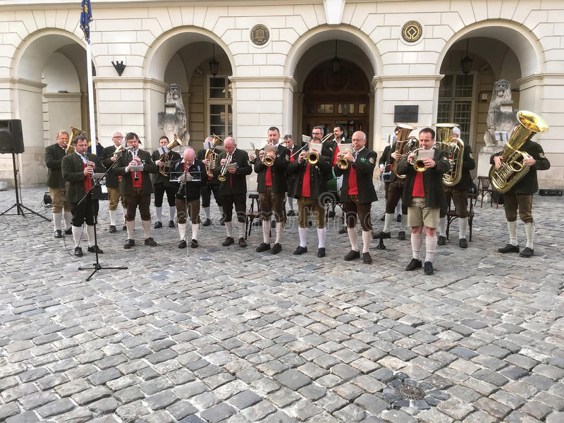 Band from Austria is playing in front of city Hall in Lviv royalty free stock image