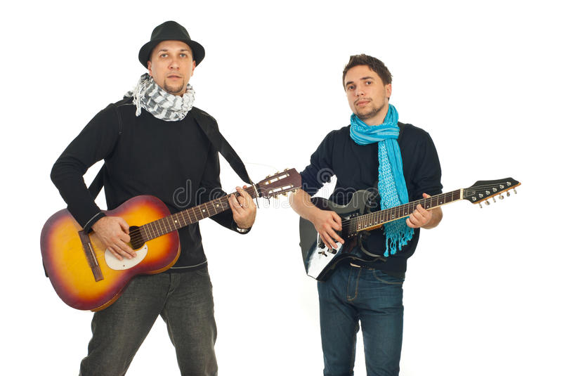 Band of guys playing guitars royalty free stock photography