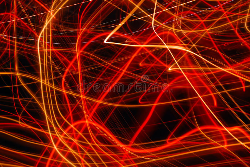 Band of lights. From candles on cemetery photographed in long time exposure royalty free stock photography
