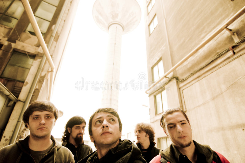Band outdoors. Alternative rock band members outdoors royalty free stock photo