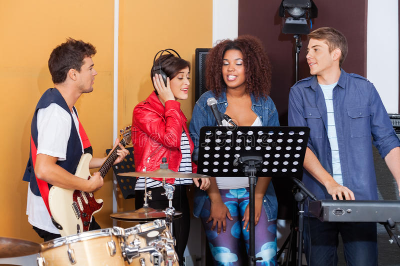 Band Performing Together In Recording Studio royalty free stock photos
