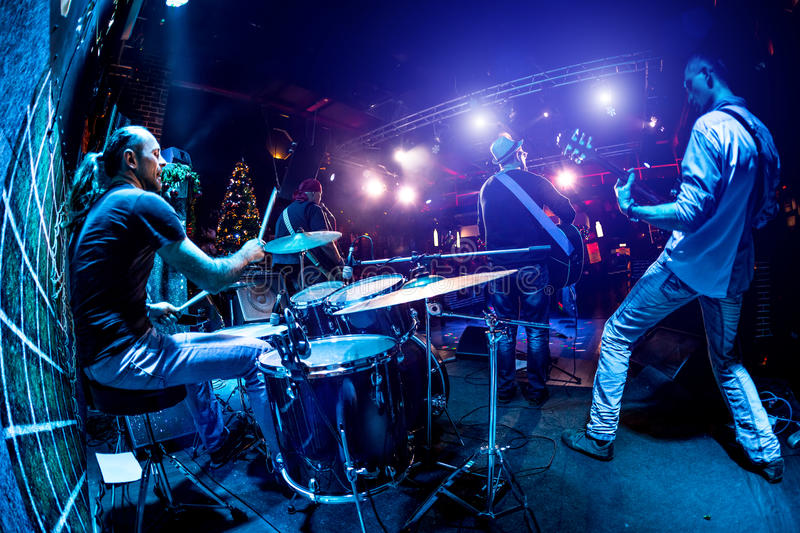 Band performs on stage. Rock music concert royalty free stock photos