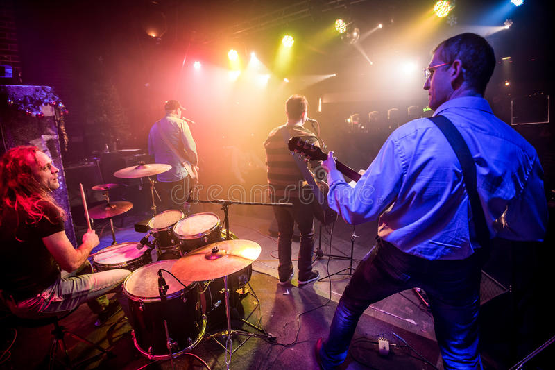 Band performs on stage. Rock music concert stock images