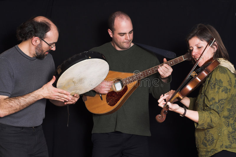 Band playing celtic music. Over black background royalty free stock photos