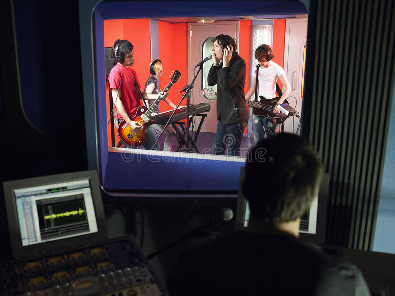Band In Recording Studio. With technician in foreground royalty free stock photos