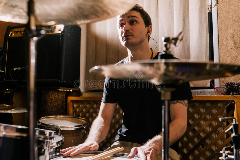 Band rehearsal. Creating new music on drums royalty free stock photo