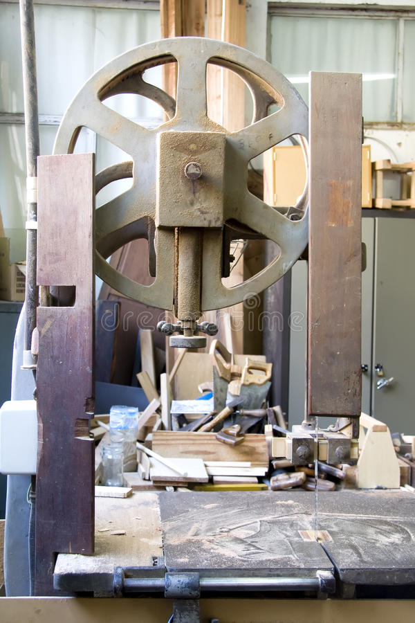 Band saw. Old band saw in a carpentry stock photo