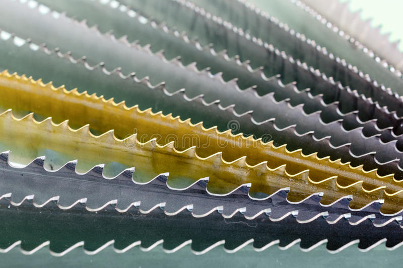 Band saw blade. Fan arrangement, macro. Abstract industrial background royalty free stock photography