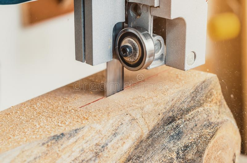 Band saw, the machine cuts the log on the boards. Woodworking, wood products, work, employment. Band saw, the machine cuts the log on boards. Woodworking, wood stock photo