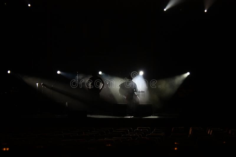 Band in shadows on stage royalty free stock image