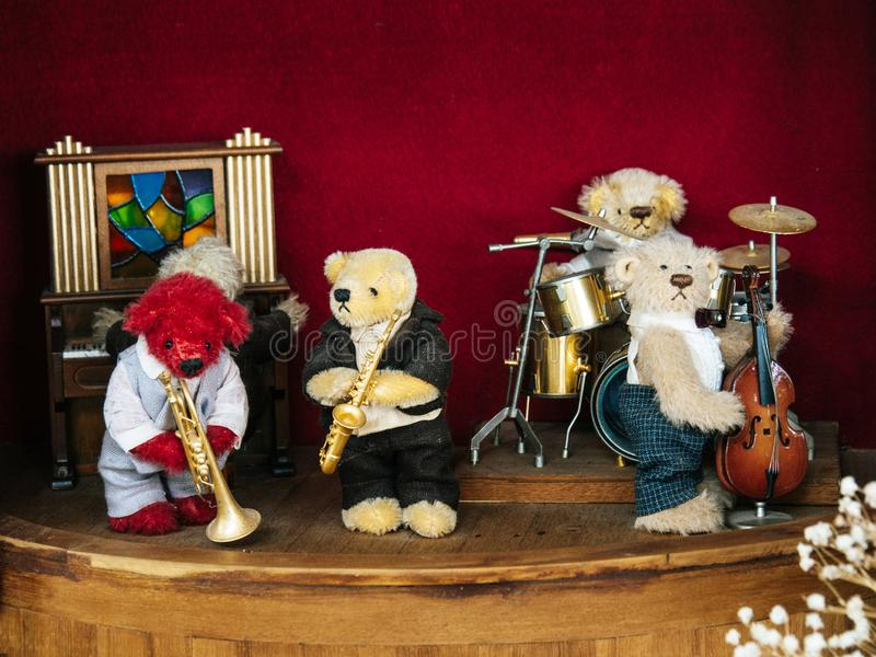 The band, teddy bear, playing music, saxophone blowing, drumming, playing piano and cello. The band, teddy bear, playing music, saxophone blowing, drumming royalty free stock photography