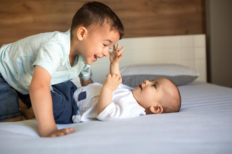 Band of two brothers on the couch. Playing together with joy and cheerfulness stock photos