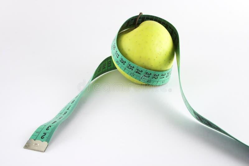Band und Apfel lizenzfreie stockfotografie