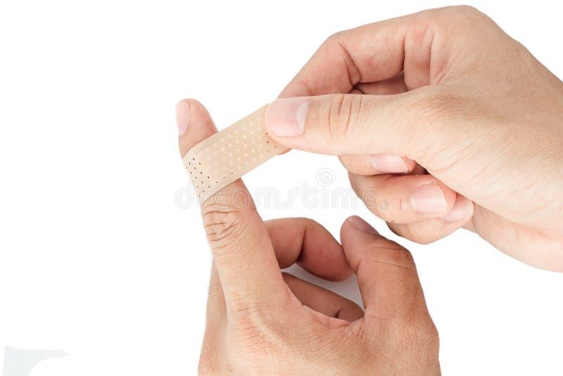 Bandaż na palcu wskazującym odizolowywa tło zdjęcie stock