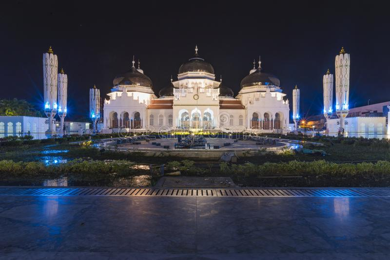 Banda Aceh, Indonesia - 07 11 2017: Baiturrahman Grand Mosque in Banda Aceh. Banda Aceh, Indonesia - 07 11 2017: Night view of Baiturrahman Grand Mosque in Banda stock image
