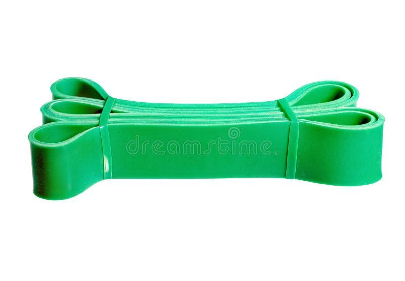 Banda di polso di gomma verde torta isolata su bianco fotografia stock libera da diritti