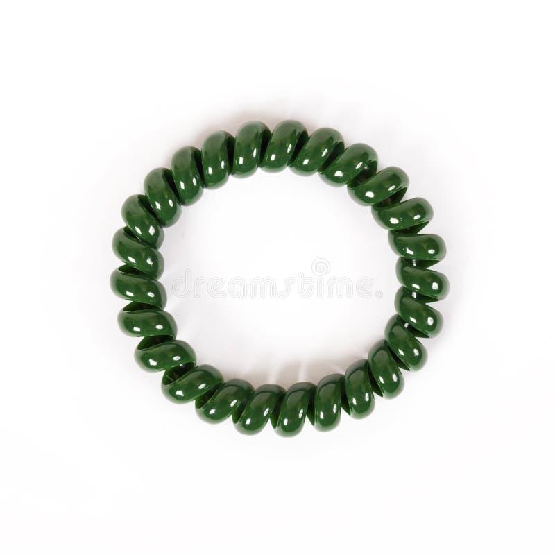 Banda elástica espiral verde redonda para el pelo fotos de archivo libres de regalías