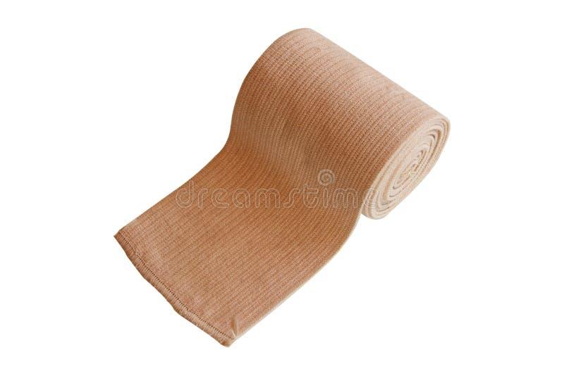 Bandage élastique de petit pain de Brown d'isolement sur le fond blanc Chemin de coupure photographie stock