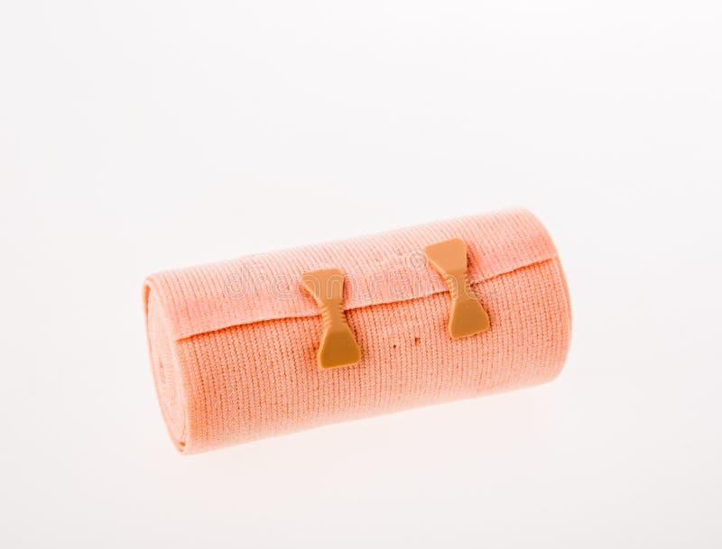 Bandage élastique sur le fond blanc photographie stock libre de droits