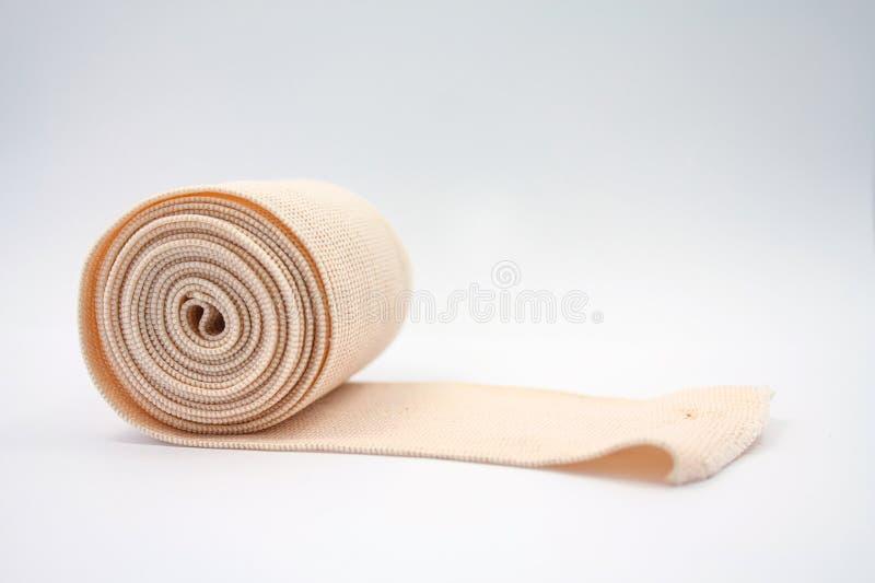 Bandage élastique sur le fond blanc image libre de droits