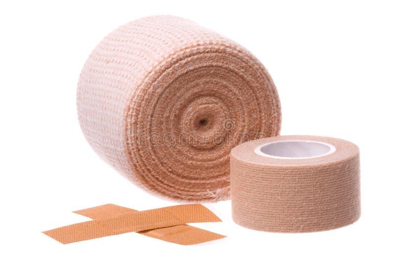 Bandages and Plasters Macro Isolated. Isolated macro image first aid bandages and plasters stock photo