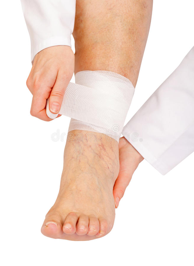 Download Bandaging the ankle stock photo. Image of nudity, body - 30639472