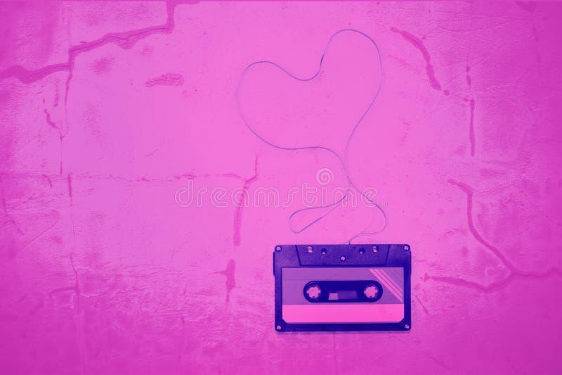 Bandband-Herzform der Kassette verwirrte lizenzfreie stockfotografie