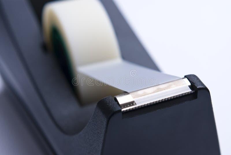 bande collante de distributeur noir image stock
