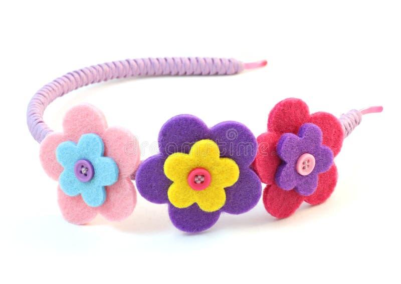 Bande de cheveu avec trois fleurs images stock