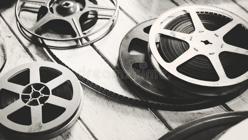Bande de film de vintage d'isolement sur le plancher en bois photo libre de droits