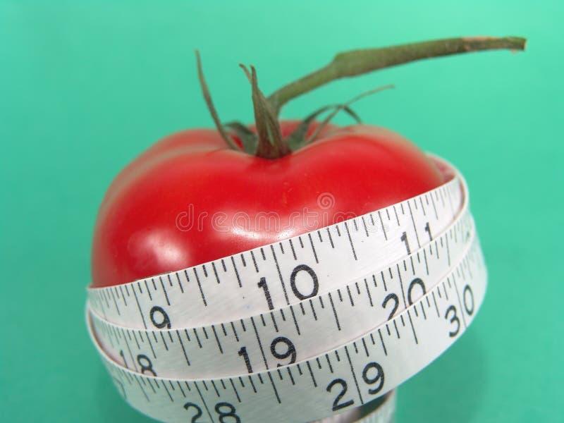 Bande de mesure de tomate photographie stock
