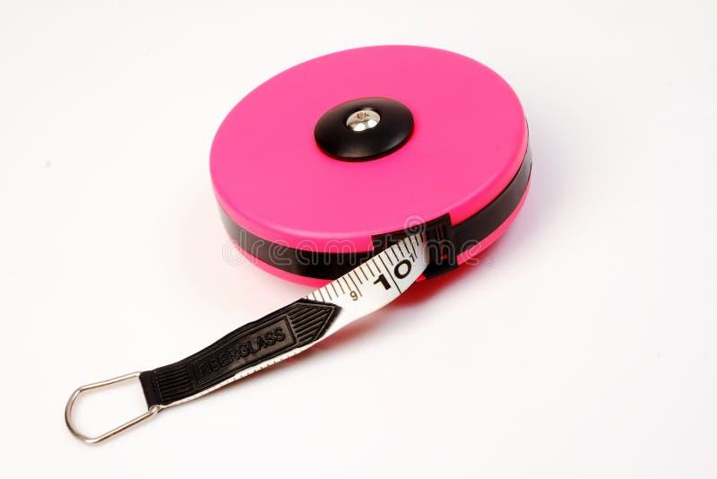 Bande de mesure rose sur le blanc photographie stock