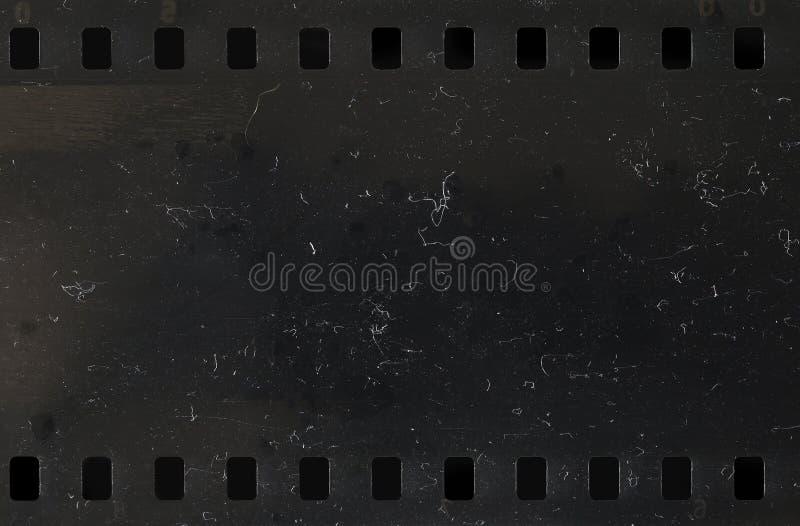 Bande de vieille pellicule à celluloïde avec la poussière et des éraflures image libre de droits