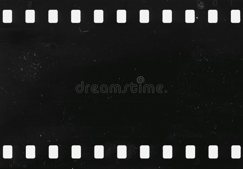 Bande de vieille pellicule à celluloïde avec la poussière et des éraflures image stock