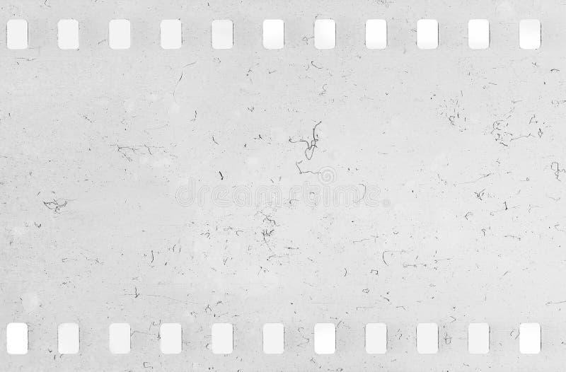 Bande de vieille pellicule à celluloïde avec la poussière et des éraflures photographie stock
