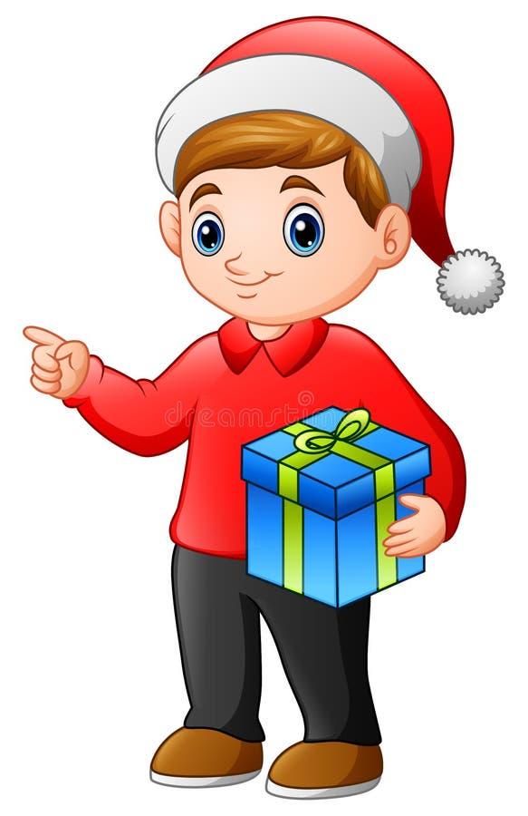 Bande dessinée de garçon d'enfant tenant un cadeau de Noël illustration de vecteur