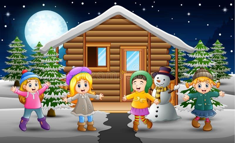 Bande dessinée des enfants heureux portant des vêtements d'un hiver devant le village de chute de neige illustration stock