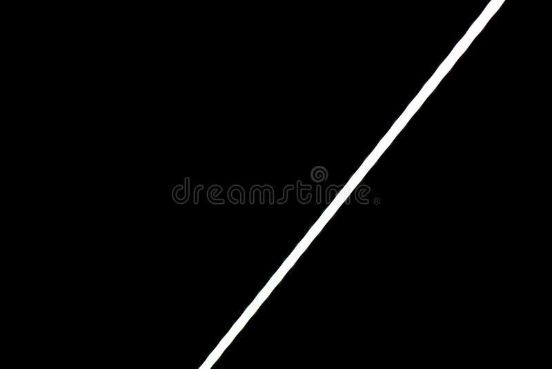 Bande légère menée blanche sur le mur noir image libre de droits