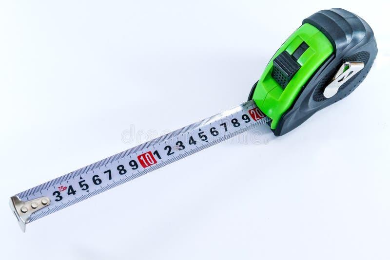 Bande-mètre de mesure dans la couleur verte noire pour la longueur de mesure photo stock