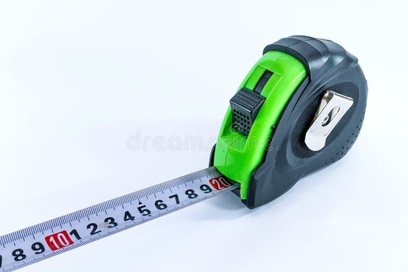 Bande-mètre de mesure dans la couleur verte noire pour la longueur de mesure image stock
