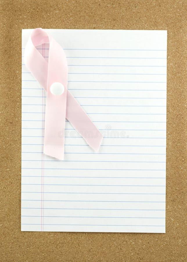 Bande rose sur la conscience de cancer du sein de note photo libre de droits
