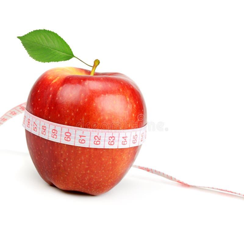 Bande rouge de pomme et de mesure photos stock